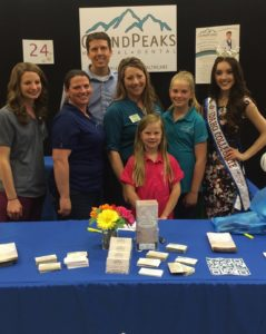 group picture taken at the Grand Peaks booth - rexburg wellness center