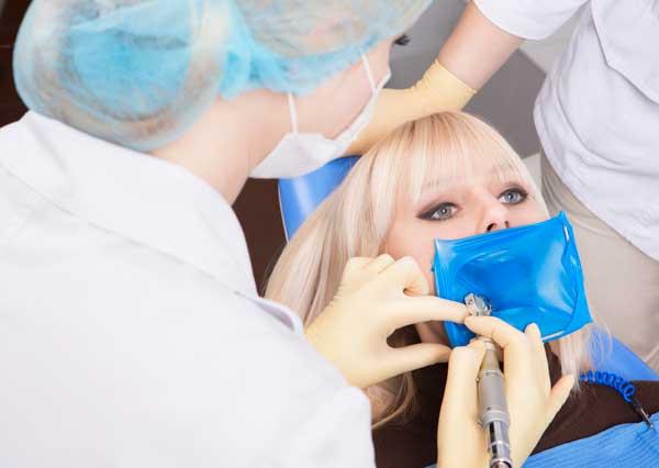 Woman Being Given A Dental Procedure - Rexburg Dental